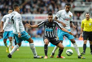 Newcastle United's Emmanuel Riviere looks to close down a pass from Hull City's Curtis Davies during the Premier League game at St.James' Park. Photo: Serena Taylor/Newcastle United via Getty Images