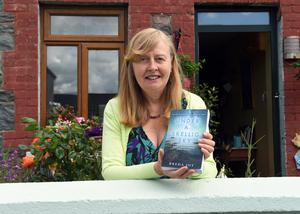 Breda Joy with her new novel 'Under a Skellig Sky'. Photo by Michelle Cooper Galvin