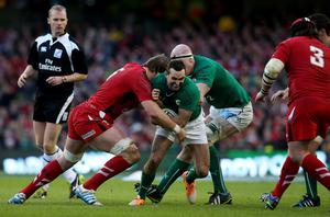 Ireland's Dave Kearney is tackled by Wales Alun-Wyn Jones (left) during the RBS 6 Nations match at the Aviva Stadium