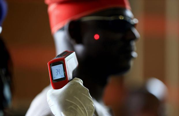 A man has his temperature taken using an infrared digital laser thermometer at the Nnamdi Azikiwe International Airport in Abuja. Reuters
