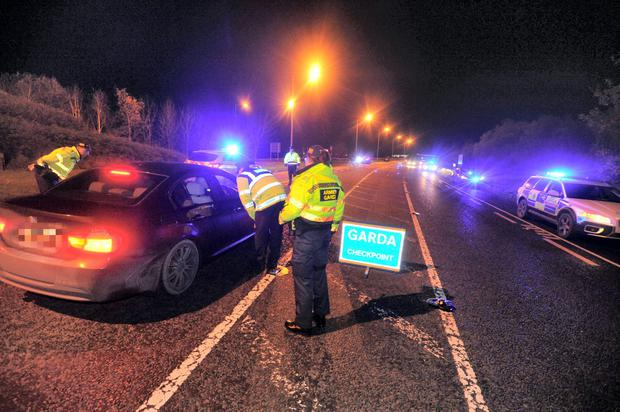 Armed gardaí assist at a checkpoint in Co Carlow