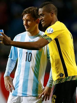 Jamaica's DeShorn Brown takes a selfie with Argentina's Lionel Messi (10) following their first round Copa America 2015 soccer match at Estadio Sausalito in Vina del Mar, Chile (REUTERS/Ivan Alvarado)