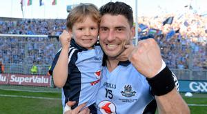 22 September 2013; Dublin's Bernard Brogan celebrates with his nephew, Jamie, son of Alan Brogan, after the game. GAA Football All-Ireland Senior Championship Final, Dublin v Mayo, Croke Park, Dublin. Picture credit: Brendan Moran / SPORTSFILE