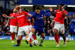 Chelsea's Eden Hazard in action with Nottingham Forest's Jack Colback and Tendayi Darikwa. Photo: Matthew Childs/Action Images via Reuters