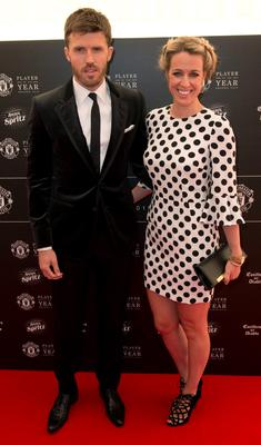Manchester United's English midfielder Michael Carrick  and his wife Lisa Roughead pose for pictures on the red carpet as they arrive to attend the 'Manchester United Player of the Year Awards' at Old Trafford stadium in Manchester, northern England, on May 19, 2015. AFP PHOTO / OLI SCARFFOLI SCARFF/AFP/Getty Images