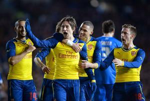 Tomas Rosicky celebrates with his Arsenal teammates after scoring his side's third goal in their FA Cup clash with Brighton at the Amex Stadium. Photo: AFP PHOTO / GLYN KIRK