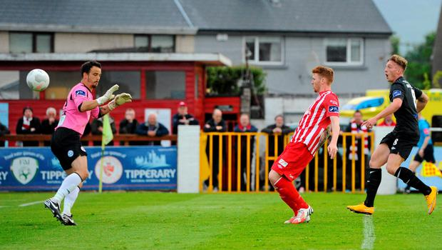 Sligo Rovers' Daniel Ledwith (centre) puts the ball past his own goalkeeper, after a cross from Dundalk's Daryl Horgan