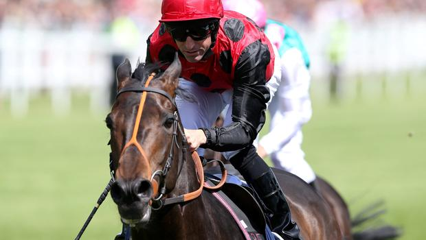 A late surge from Pat Dobbs on Pether's Moon win the 3:10 Investec Coronation Cup