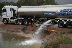 Peter Smith delivers water by truck to a holding pond in the drought-affected town of Murrurundi, New South Wales, Australia February 17, 2020. Picture taken February 17, 2020.  REUTERS/Loren Elliott