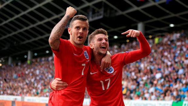 ***alternative crop*** England's Jack Wilshire (left) celebrates with team mate Adam Lallana (right) after scoring his sides second goal of the game during the UEFA European Championship Qualifying match at the Stozice Stadium, Slovenia. PRESS ASSOCIATION Photo. Picture date: Sunday June 14, 2015. See PA story SOCCER Slovenia. Photo credit should read: Mike Egerton/PA Wire. RESTRICTIONS: Use subject to FA restrictions. Editorial use only. Commercial use only with prior written consent of the FA. No editing except cropping. Call +44 (0)1158 447447 or see www.paphotos.com/info/ for full restrictions and further information.