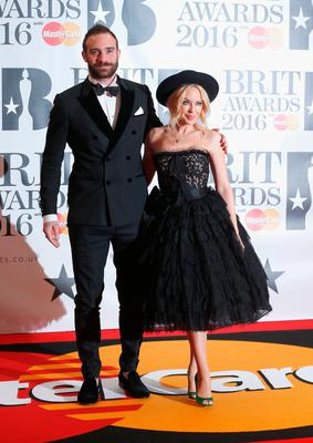 Joshua Sasse and Kylie Minogue attends the BRIT Awards 2016 at The O2 Arena on February 24, 2016 in London, England.  (Photo by Luca Teuchmann/Getty Images)