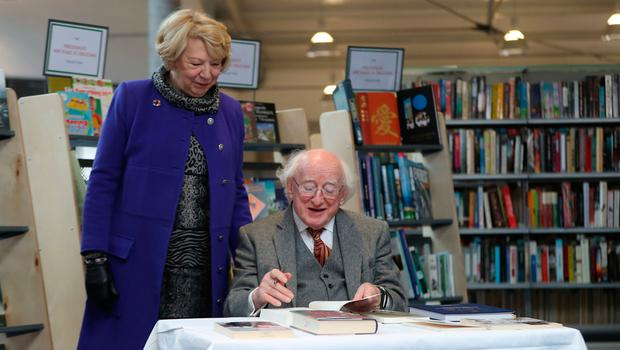 President Michael D Higgins signs some of his own books at Cabra Library in Dublin before he donates part of his personal book collection to Dublin City Libraries.  Photo: Niall Carson/PA Wire