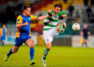 Rovers' Michael Drennan tries to take the ball under control as he's closed down by Bray's Michael Barker