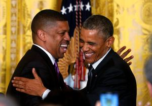 U.S President Barack Obama hugs Sacramento Mayor and former NBA basketball player Kevin Johnson who introduced him to speak at the U.S. Conference of Mayors at the White House in Washington January 23 (REUTERS/Kevin Lamarque)
