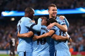 MANCHESTER, ENGLAND - SEPTEMBER 30:  Sergio Aguero of Manchester City celebrates scoring the opening goal from a penalty kick with his team-mates during the UEFA Champions League Group E match between Manchester City FC and AS Roma  on September 30, 2014 in Manchester, United Kingdom.  (Photo by Alex Livesey/Getty Images)
