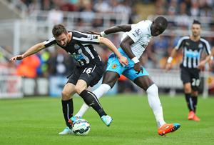 Newcastle United defender Paul Dummett vies with Hull City's Mohamed Diame during the Premier League game at St.James' Park. Photo: Ian MacNicol/AFP/Getty Images