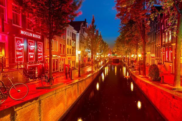 In the Netherlands, where prostitution is legal and regulated, there are about three-hundred cabins rented by prostitutes in Amsterdam's red-light district Photo: Sergey Borisov