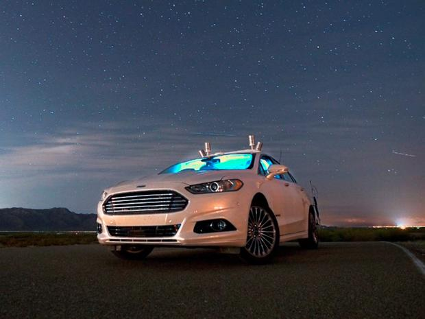 The Ford Fusion Hybrid tipped around a closed circuit in the dark - with its lights off.