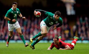 Ireland's Jared Payne gets past Wales Jamie Roberts during the RBS 6 Nations match at the Millennium Stadium