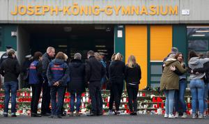 Relatives of students and members of Special Assistance Team stand in front of the Joseph-Koenig-Gymnasium high school in Haltern am See, March, 25, 2015. REUTERS/Ina Fassbender