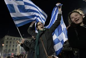 Anti-austerity Syriza supporters celebrate after the first exit polls in Athens. Photo: AFP PHOTO / ARIS MESSINISARIS MESSINIS/AFP/Getty Images
