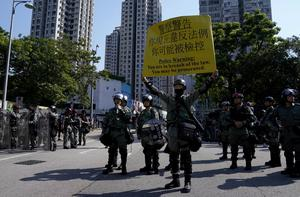 Riot police hold a sign during an anti-government march in Tuen Mun, Hong Kong, China September 21, 2019. REUTERS/Aly Song