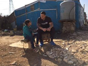 Sonny Bill Williams speaks with a child in a refugee camp in Lebanon earlier this month