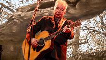 This June 15, 2019 file photo shows John Prine performing at the Bonnaroo Music and Arts Festival in Manchester, Tenn.  (Photo by Amy Harris/Invision/AP, File)