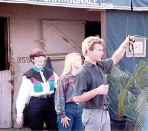 Julia Holmes with her stepdaugher Kimberly in the centre, and Hollywood actor Patrick Swayze at an event in Texas