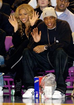 Singer/Actress Beyonce Knowles and her boyfriend rapper Jay-Z watch the New York Knicks in 2002