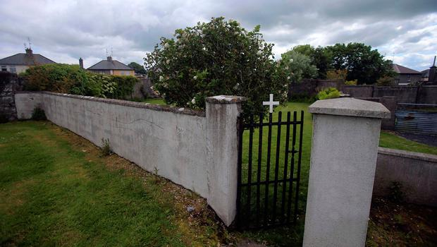 The entrance to the site of a mass grave of hundreds of children who died in the former Bons Secours home for unmarried mothers is seen in Tuam, County Galway. Photo: Reuters