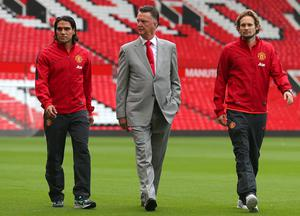 Manchester United manager Louis van Gaal (centre) with his new signings Radamel Falcao (left) and Daley Blind during a photocall at Old Trafford, Manchester