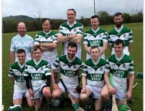 The five fathers and fives sons pose for a photo after their victory