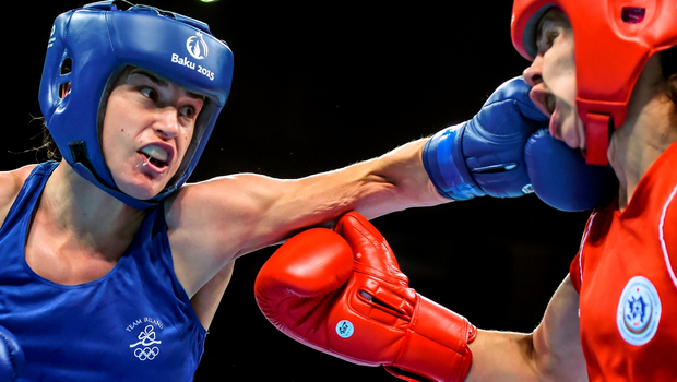 Katie Taylor scores with a left on her way to beating Yana Alekseevna in their lightweight semi-final in Baku