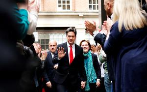 Labour leader Ed Miliband arrives with his wife Justine at the Labour party central office in Brewer's Green, London after travelling down from his Doncaster constituency, as according to reports he is expected to resign following sweeping losses in Scotland and with David Cameron close to an overall majority. PRESS ASSOCIATION Photo. Picture date: Friday May 8, 2015. See PA story ELECTION Labour. Photo credit should read: Yui Mok/PA Wire
