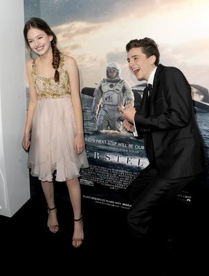"""Actors Mackenzie Foy (L) and Timothée Chalamet attend the premiere of Paramount Pictures' """"Interstellar"""" at TCL Chinese Theatre IMAX"""
