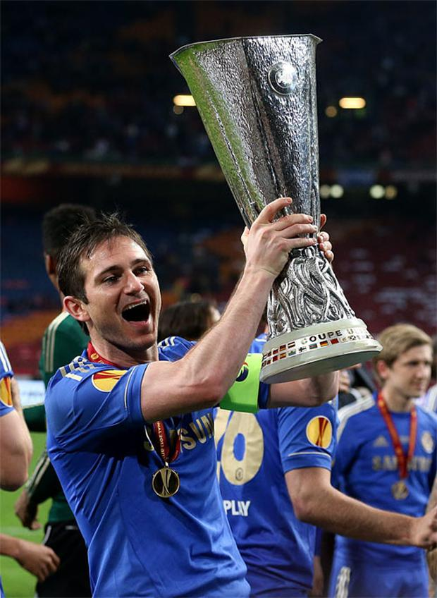 15 May: Chelsea's Frank Lampard with the UEFA Europa League trophy after winning the UEFA Europa League Final against Benfica at the Amsterdam Arena
