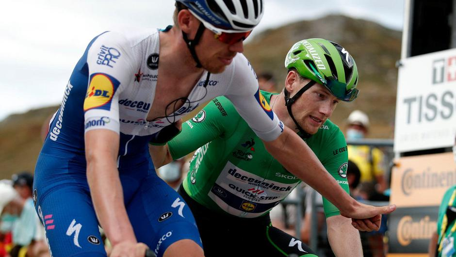 Ireland's Sam Bennett, wearing the best sprinters green jersey, crosses the line with Belgium's Tim Declercq after a tough 191km stage from Chatel-Guyon to Puy Mary. Photo: AP