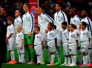 England's Wayne Rooney lines up with team-mates and mascot Romeo Beckham prior to the UEFA European Qualifying match at Wembley Stadium, London. PRESS ASSOCIATION Photo. Picture date: Tuesday September 8, 2015. See PA story SOCCER England. Photo credit should read: Nick Potts/PA Wire. RESTRICTIONS: Use subject to FA restrictions. Editorial use only. Commercial use only with prior written consent of the FA. No editing except cropping. Call +44 (0)1158 447447 or see www.paphotos.com/info/ for full restrictions and further information.
