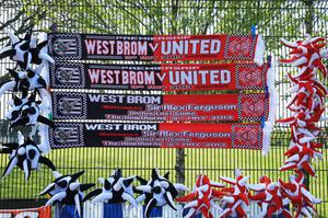 Scarves on display marking Manchester United manager Sir Alex Ferguson's 1,500th and final match in charge of the club