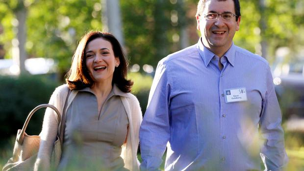 Sheryl Sandberg, Chief Operating Officer (COO) of Facebook, arrives with her husband David Goldberg, CEO of SurveyMonkey, for the first day of the Allen and Co. media conference in Sun Valley, Idaho in this July 9, 2014, file photo. SurveyMonkey CEO and husband of Facebook Chief Operating Officer Sheryl Sandberg, Dave Goldberg, died unexpectedly on Friday night, his brother Robert wrote in a Facebook post on May 2, 2015.  REUTERS/Rick Wilking/Files