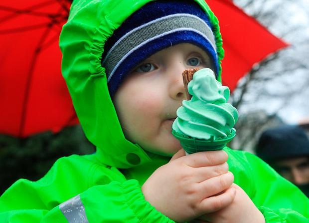 Maud Hickey enjoys a patriotic ice cream in the rain at the Killarney parade Picture: Valerie O'Sullivan