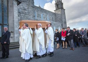 The coffin followed by family members is taken to the crypt at the cathedral. Photos: Tony Gavin