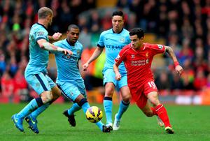 Liverpool's Philippe Coutinho is closed down by Manchester City trio Pablo Zabaleta, Fernandinho and Samir Nasri during their Premier League clash at Anfield. Photo: Clive Brunskill/Getty Images