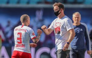 Leipzig coach Julian Nagelsmann celebrates with Angelino afte the Germarn Bundesliga soccer match between RB Leipzig and SC Freiburg. (Jan Woitas/dpa via AP)