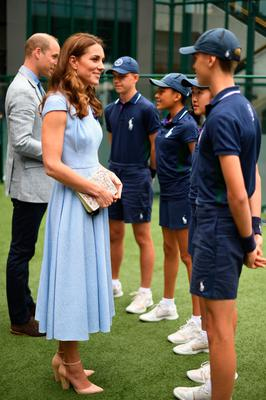 The Duke and Duchess of Cambridge meet ballboys and ballgirls (left to right) Tom Hubner, 15, Rhianne Black, 14, Kayleigh Man, 13 and Cassius Hayman, 15, ahead of the Men's Singles Final on day thirteen of the Wimbledon Championships at the All England Lawn Tennis and Croquet Club, Wimbledon.Sunday July 14, 2019. See PA story SPORT Wimbledon.  Victoria Jones/PA Wire