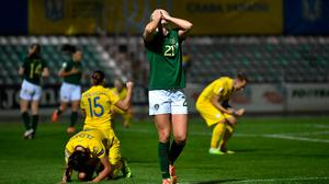 Ruesha Littlejohn of Republic of Ireland reacts at the full-time whistle, as Ukraine players celebrate, following the UEFA Women's EURO 2022 Qualifier match at the Obolon Arena in Kyiv, Ukraine. Photo by Stephen McCarthy/Sportsfile