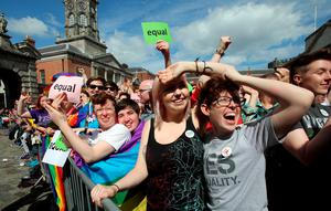 Supporters for same-sex marriage raise a cheer at Dublin Castle as they wait for the result of the referendum on May 23, 2015. Yes voters were basking in the sunshine today as they gathered to celebrate an expected victory in Ireland's referendum on whether to approve same-sex marriage. AFP PHOTO /  Paul FaithPAUL FAITH/AFP/Getty Images