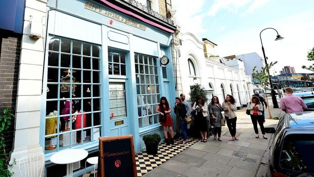 Shoppers form a line outside Mary's Living and Giving Shop in Primrose Hill, London, as clothes belonging to Harper Beckham were put on sale