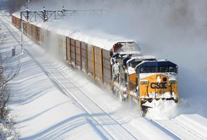 A CSX freight train plows its way past the Cemetery Rd. overpass in Lancaster,  N.Y. Wednesday (AP Photo/Gary Wiepert)